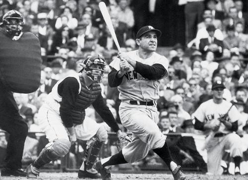 Yogi Berra hitting a home run in the 1960 World Series.  Neil Leifer/SI